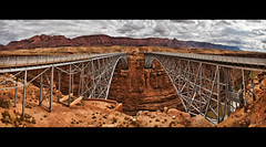 navajo bridge - arizona (Dan Anderson (dead camera, RIP)) Tags: bridge arizona panorama rain highway desert pano bridges twin az double symmetry coloradoriver leesferry marblecanyon navajobridge twinspan steelarch top20bridges