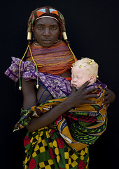 Albino baby girl and her Mwila mother - Angola (Eric Lafforgue) Tags: africa camera two people baby shells tourism up dreadlocks standing beads kid child looking african traditional group mother culture tribal maternity waist innocence albino tribes blackpeople bebe tradition tribe ethnic hairstyle cultura plaits tribo angola ethnology tribu tourismo herero albinos etnia mwela tnico etnias 3567 cauri angolan ethnie hereros  childwoman mumuila   suldeangola mumuhuila mwila      muwila southangola nontombi