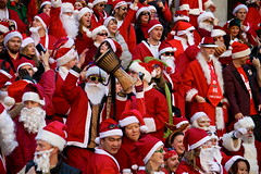 Santacon 2010 (Eyesplash - There is a change in the air.) Tags: santa christmas xmas costumes red people men art hat sunglasses goofy fun women funny drum beards fringe parade celebration event gathering santaclaus drunks laughter kriskringle pranks pubcrawl flashmob iphone subversion cacophony santarchy cacophonous santacon2010 desaturatedsantanothere kringlekaos santaconvan