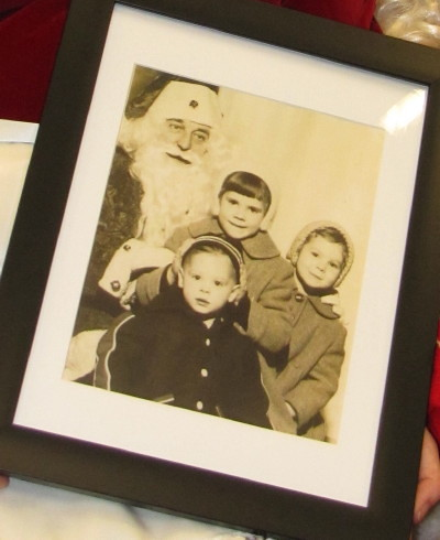 Lynda Luxton's 1957 picture of 'posing with Santa' depicting herself (far right), her sister Carole and brother Ronnie sitting on Santa's lap taken at the old Woodward's store