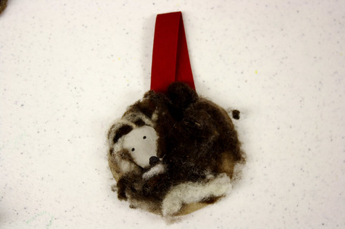 we used real sheep wool to cover little ovals of cardboard