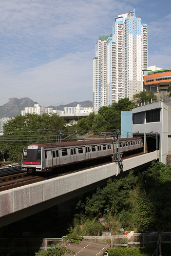 Train bound for Yau Ma Tei head back underground at Kowloon Bay