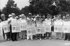 "ILGWU senior female members and retirees holding placards urging ""fair play for the aged"", ""hands off social security"", ""don't mess with medicare"", ""keep your promises Mr. President"", and more. by Kheel Center, Cornell University"