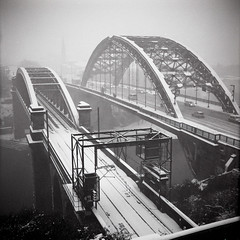 Wearmouth Bridges (boscoppa) Tags: uk bridge england bw 120 6x6 film zeiss train metro rail wear ikon ilford fp4 sunderland nettar wearmouth