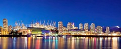 A Changing Skyline ([travelfox]) Tags: city longexposure travel winter panorama snow canada skyline vancouver buildings reflections boats downtown chinatown bc nightshot britishcolumbia yaletown falsecreek nightshots bluehour gastown grousemountain vancouverlookout bcplacestadium rogersarena canon50d edgewatercasino
