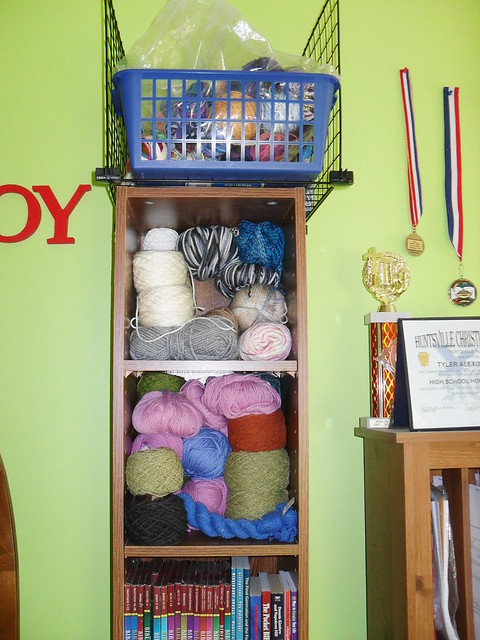bookshelf of yarn stash at Tyler Handmade