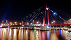 Willemsbrug @ Moonlight (DolliaSH) Tags: city longexposure trip travel bridge light vacation urban holiday holland color tourism water colors architecture night canon reflections river puente photography lights noche photo rotterdam topf50 europe foto tour place nightshot photos nacht harbour nederland thenetherlands wideangle visit location tourist ponte most le journey pont destination traveling brug maas visiting topf150 brcke topf100 ultrawide nuit 1022mm notte touring stad 1022 afterdark willemsbrug noch zuidholland brucke rivier canonefs1022mmf3545usm southholland 50d nachtopname canoneos50d dollia dollias sheombar dolliash