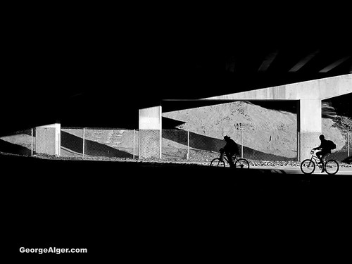Bicycle Riders Under Bridge