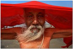 mr. red riding hood (Soumya Bandyopadhyay) Tags: red portrait colors bath dry clothes holy sadhu sankranti makar westbengal gangasagar canon1785mmis canoneos40d
