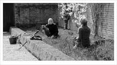 Lady gardeners. (David M:) Tags: street uk trip travel light shadow england people blackandwhite bw sunlight color colour art english monochrome beautiful beauty sunshine composition contrast photoshop bucket spring nikon europe raw image britain candid curves north norfolk picture fork scene structure sharp photograph shade elements hedge saturation british form shape effect horticulture tone levels available tonal black white compose felbrigg ~davem~