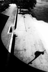 Reign of shadows (Vanvan_fr) Tags: monochrome nb bw noiretblanc blackandwhite dark ombres shadows light quai quay eau water fleuve river laloire vide empty vueenplonge overheadview urban urbain ville city tours france photo gr