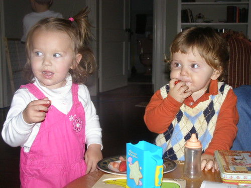 Andre and Ella. eating strawberries and scheming.