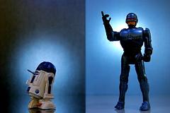 R2-D2 vs. RoboCop (341/365) (JD Hancock) Tags: favorite fun toy actionfigure robot photo starwars technology tech image action picture cc r2d2 figure duel char robocop onblue day341 inkitchen jdhancock duel365