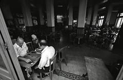 Egypt - Alexandria (luca marella) Tags: street people bw white playing black game film bar board voigtlander bessa pb bn bianco nero egitto backgammon alessandria analogic marellaluca