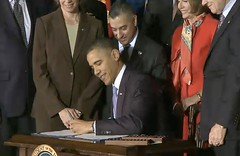President Obama Signing the Repeal