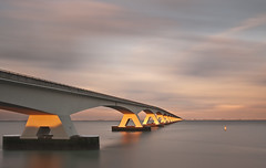 The bridge (George Goodnight) Tags: longexposure bridge winter sunset sky snow cold water nikon zeeland netherland zeelandbridge nd110 nikond300 georgegoodnightphotography
