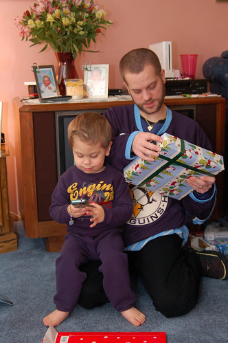 Christmas Eve:  Noah placing an important call while Mike opens his present.