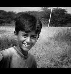May the love hidden deep inside your heart find the love waiting in your dreams. May the laughter that you find in your tomorrow wipe away the pain you find in your yesterdays. (legends2k) Tags: boy portrait blackandwhite monochrome smile lumix indian innocent shy panasonic lad g1 hyderabad fourthirds countenance manjira manjeera microfourthirds panasonicdmcg1