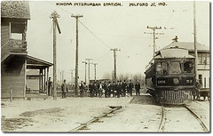 Winona Interurban Station, Milford Junction, Indiana (Hoosier Recollections) Tags: people woman usa signs man men history industry boys station kids buildings walking children clothing women workmen crowd indiana machinery transportation porch pedestrians depot interurban trolleys businesses wagons realphoto kosciuskocounty milfordjunction hoosierrecollections