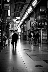 two different Saturday nights (StephenCairns) Tags: blackandwhite man night mall saturday oldman  gifu    sigma30mmf14 yanagase canoneos50d canon50d japaninbw   50d 30mmf14