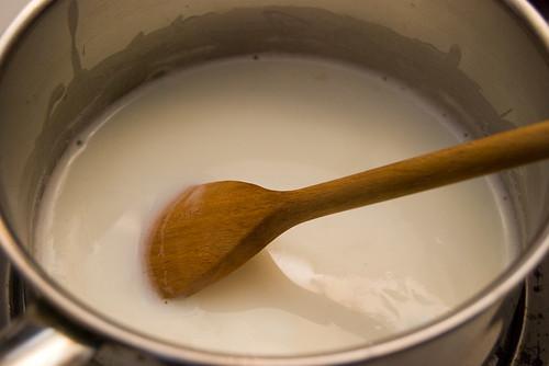 Stir milk and water