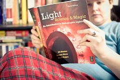 18/365 - Light: Science & Magic (acousticgirl) Tags: me 35mm book nikon bokeh sb600 alienbees d90 365days studioflash b800 strobist offcameralighting 365project 365daysselfportrait nikond90