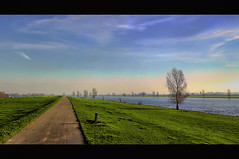 River view 2 (Wim Koopman) Tags: sky holland tree water netherlands grass clouds river photography photo stock dyke rhine rijn stockphoto merwede stockphotography wpk dutchaltena