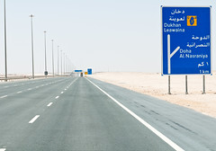 From Doha to Dukhan (christian.senger) Tags: road travel blue sky brown texture abandoned sign yellow digital truck geotagged concrete grey dangerous nikon asia outdoor stones gray line freeway minimalism distance qatar lightroom d300 fatamorgana gettyvacation2010 christiansenger:year=2011