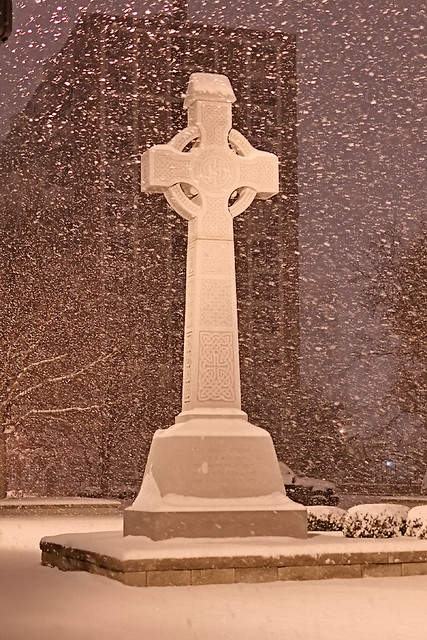 Saint John the Apostle and Evangelist Catholic Church, in Saint Louis, Missouri, USA - Celtic Cross, at night in the snow