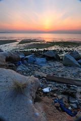 Low tide... (ChR!s H@rR!0t) Tags: sea sun sunrise sand rubbish penang mygearandmepremium