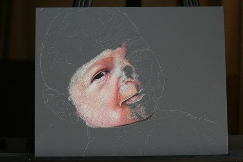In progress colored pencil drawing of a newborn.