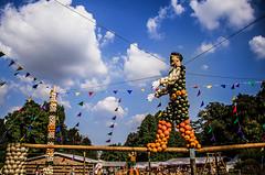 Highwire (Melissa Maples) Tags: ludwigsburg germany europe nikon d5100   nikkor afs 18200mm f3556g 18200mmf3556g vr residenzschloss palace blhendesbarock garden summer krbisausstellung pumpkins pumpkin festival sculpture art circus acrobat highwire tightrope clouds