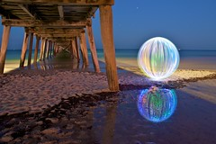 Ball of Light - Warming Up (biskitboy) Tags: sea lightpainting ball reflections circle pier sand jetty sphere round adelaide southaustralia grange refection balloflight lapp 450d grangejetty thepowerofnow