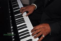 Comfort and Enjoyment (2HandzUp1913) Tags: camera music man male keys hotel hands nikon photographer fingers piano ivory jewelry ring event instrument africanamerican hyatt 2009 ebony unityball d90 eventphotography dsc2475 2handzup1913