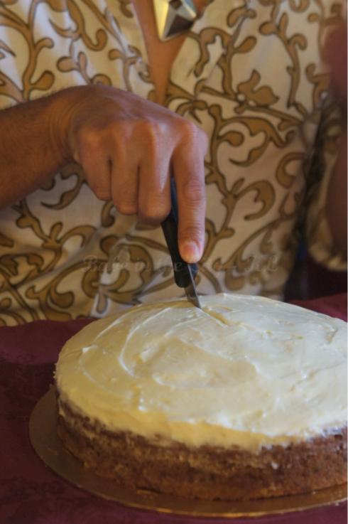 Master baker cutting cake