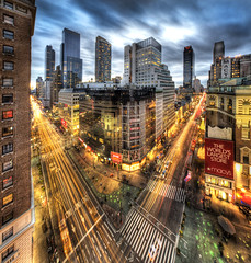 Herald Sqaure in Manhattan (Tony Shi.) Tags: herald sq square hotel asa macys mega store 34th 34 manhattan ny nyc newyork new york city daffys pennstation light stroke traffic trails hdr heavy wide angle shopping crowded staples greeleysquare broadway 6thave      nuevayork  nikond700 tonyshi photo cloudy night cityscape onthemove architecture traveldestinations vertical blurredmotion outdoors skyline usa sky cloud dusk newyorkstate newyorkcity sixthavenue illuminated skyscraper colorimage citylife 34thstreet nopeople buildingexterior photography