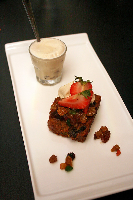 Rich fruit cake with shot glass of whisky-vanilla ice cream