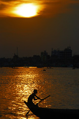 Sunset at Buriganga (Tipu Kibria~~BUSY~~) Tags: city sunset people reflection water canon river dark eos evening boat colours lifestyle dhaka 1001nights bangladesh boatman daybreak sadarghat endofday buriganga canonefs1785mmisusm xti 400d