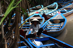 The Sampan Woman (marcusorange) Tags: travel blue water colors canon river boats colours delta row vietnam waters mekongdelta mekong sampan mekongriver 60d