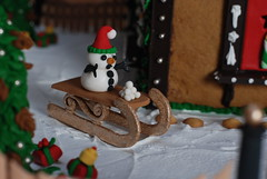 Dashing through the snow! (ineedathis, Everyday I get up, it's a great day!) Tags: christmas red white snow tree green festive miniatures baking snowman modeling sugar gifts gingerbreadhouse merrychristmas snowballs pinecones 2010 gumpaste royalicing sleight nikond80