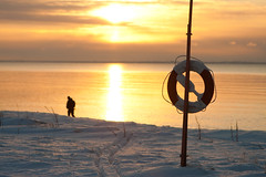 Man in sunset (Jimmy Svensson) Tags: winter sunset snow beach skne lifebuoy strandbaden vinterfoton