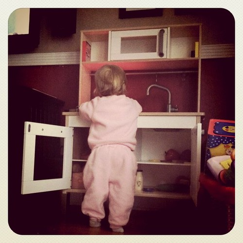 Playing in her new kitchen