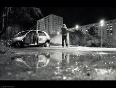 clio (Le***Refs *PHOTOGRAPHIE*) Tags: longexposure light bw white black reflection water car rain night fire nikon pluie voiture nb explore reflet burn nimes frontpage nuit hlm batiment banlieue zup d90 burnedcar zupnord lerefs