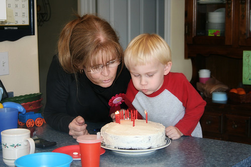 Nana blowing out her birthday candles with Nathan