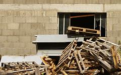 Waste and Window (genf) Tags: wood sun sunlight france broken window wall minolta 5d konica frankrijk waste pallets zon hout raam muur zonlicht afval kapot
