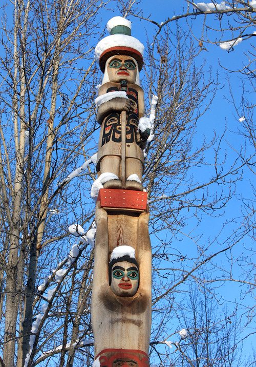 totem pole with snow at the Alaska Native Heritage Center, Anchorage, Alaska