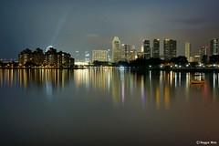 The city skyline. (Reggie Wan) Tags: evening singapore asia southeastasia marinabay kallangriver singaporeskyline sonya700 sonyalpha700 reggiewan