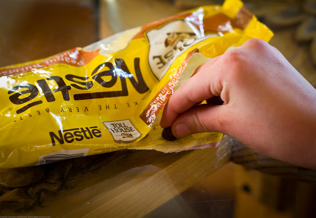 Snitching Nestle Chocolate Morsels by Dave Dugdale, on Flickr