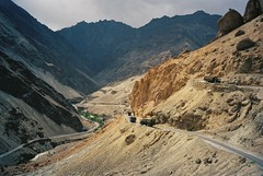 Approaching the Oasis - Ladakh (Mariasme) Tags: mountains contrast desert oasis trucks roads 1985 himalayas ladakh switchbacks descending jammukashmir fotocompetition fotocompetitionbronze yourockwinner gamesweepwinner fromyourtravels