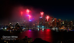 The city lights up! (damian_white) Tags: city reflection water skyline boats twilight december fireworks sydney australia celebration newyearseve sydneyharbour 2010 sydneyoperahouse